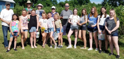 Blueberry picking at the Sikers'. We picked enough to make 20 cases of blueberry jam, which was sold at the Waterford Fair to support our 2020 mission trip.