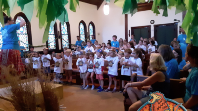 Rev. Molly leads songs at this year's VBS. We had a lot of fun and learned lots about God's goodness.